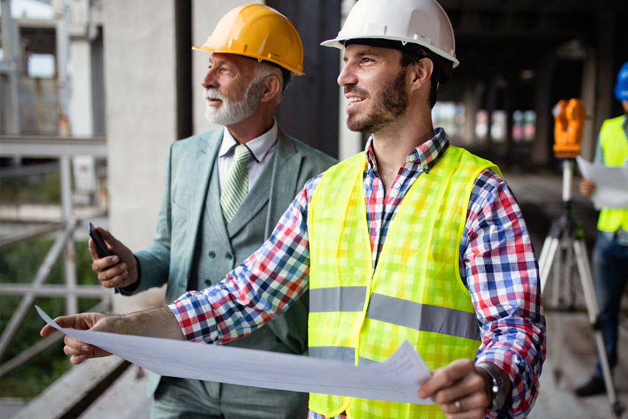 Specialized Business Insurance - Contractors Talking About a Construction Project